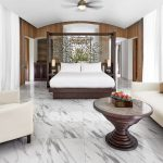 deluxe beach villa bedroom 1063x614 880x614 2 conrad maldives rangali island